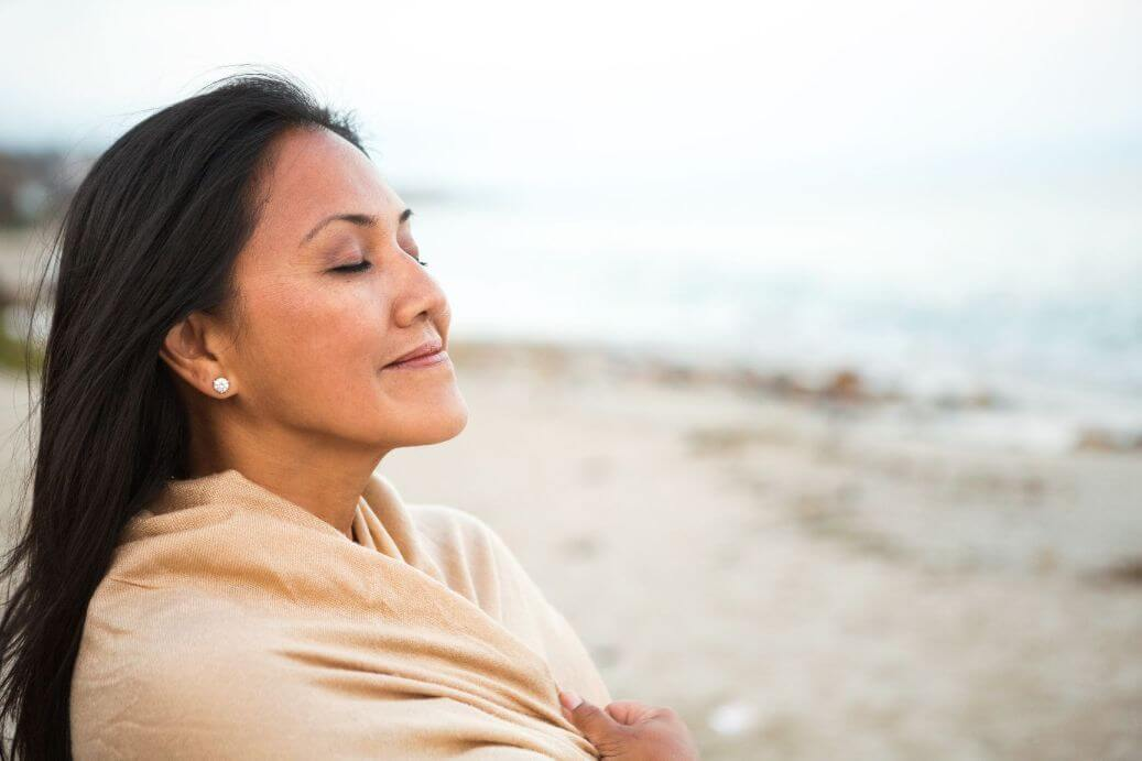 Woman smiling at peace knowing God's will for her life in empty nest
