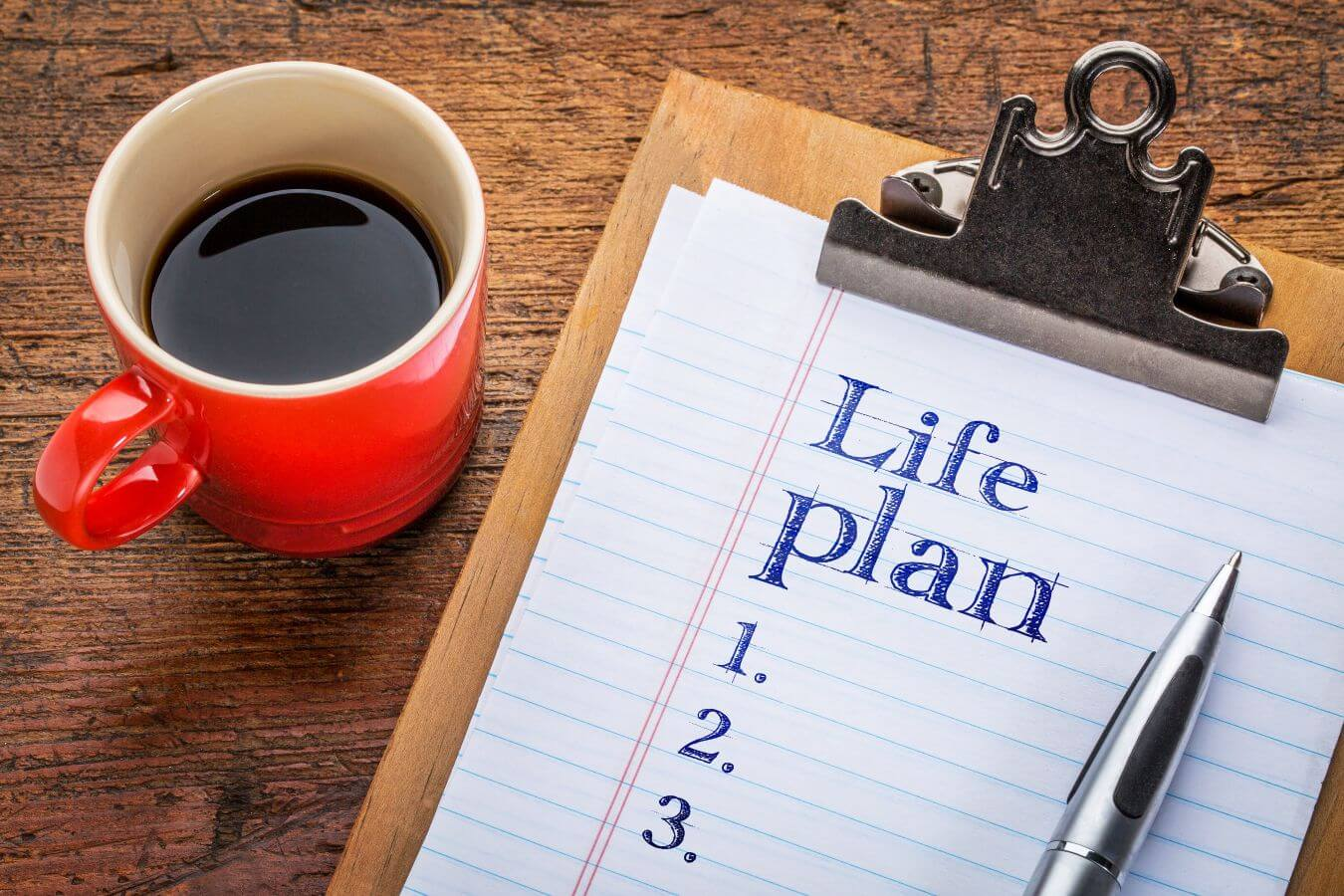 Coffee cup and clipboard with Life Plan written on paper