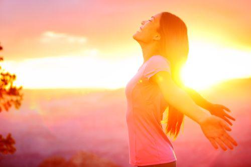 Empty nest mom in sunset joyfully seeking God's vision for her life