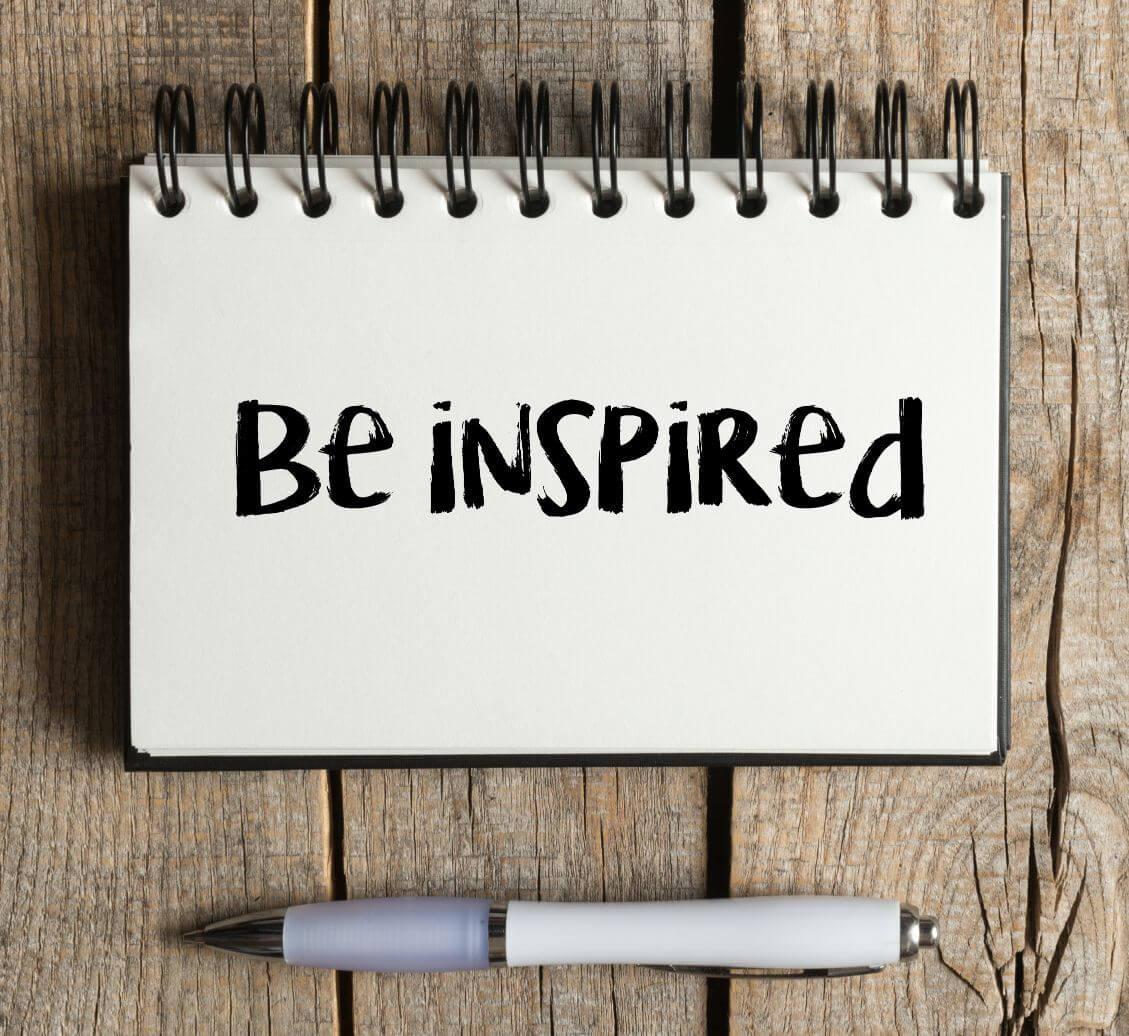 Be inspired written on notebook