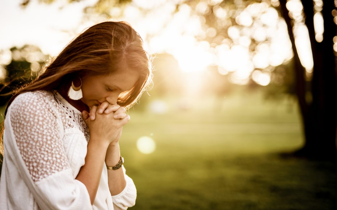 Woman praying to find purpose as an empty nester