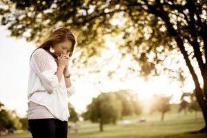 Christian woman praying for God's purpose