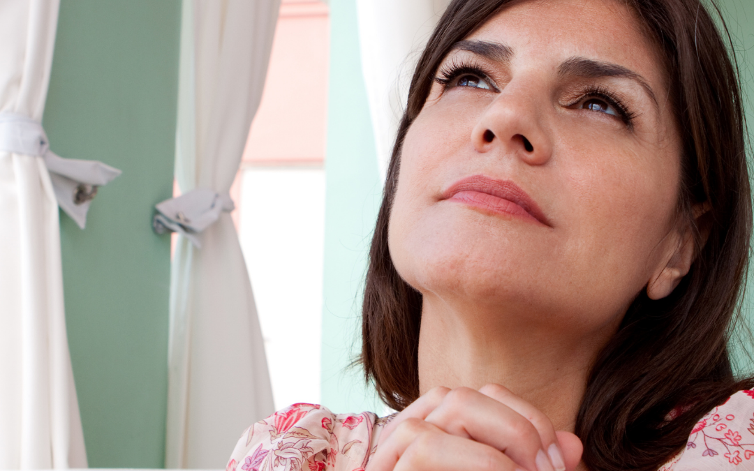 Woman in midlife offering prayers for purpose and direction in life